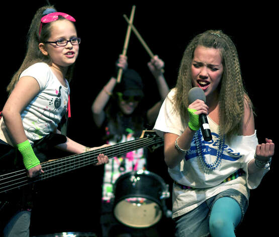 "Allie LaPerch, 10, on bass, Emily Lessa, 11, on the drums, and vocalist Taylor Hay, 10, offer ""You Keep Me Hangin' On"" by Kim Wilde and her band from 1987. The Troop 40237 members were dueling fellow Girl Scouts Rachel Sherwood, 11, Phair Haldin, 10, and Julia Kenny, 10, who were singing as the Supremes, April 1, 2011 at New Milford High School. Photo: Trish Haldin"