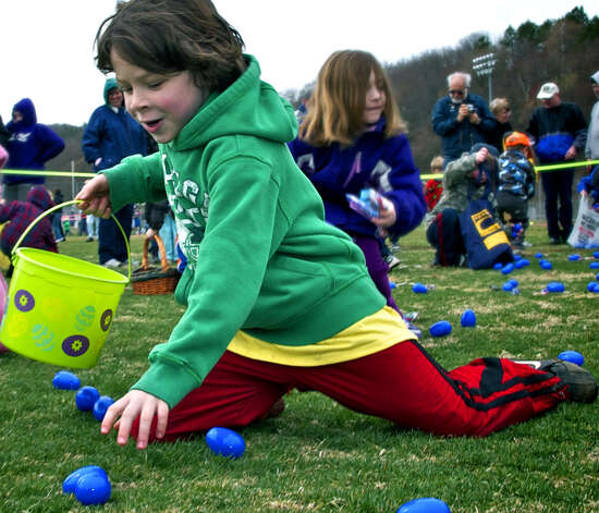 R.J. Harkin, 8, of New Milford enjoys the challenge of harvesting as many eggs as possible as he participates in the age 7-8 division of New Milford Parks & Recreation's annual Easter egg hunt in 2011. Photo: Trish Haldin