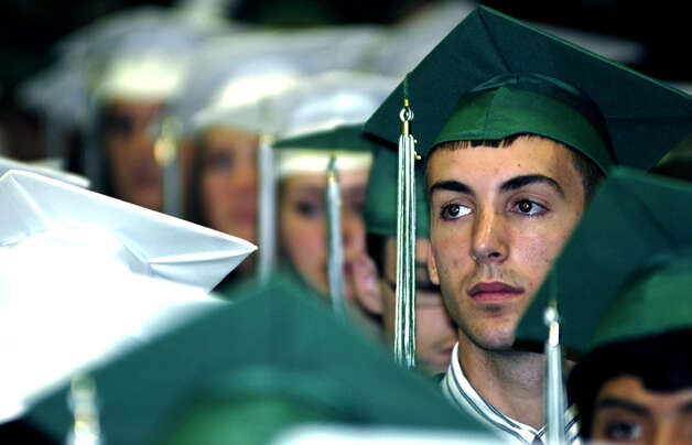 Steven Cronin appears deep in thought June 25, 2011 while listening to a speaker at the New Milford High School commencement exercises  at the O'Neill Center on the campus of Western Connecticut State University in Danbury. Photo: Norm Cummings