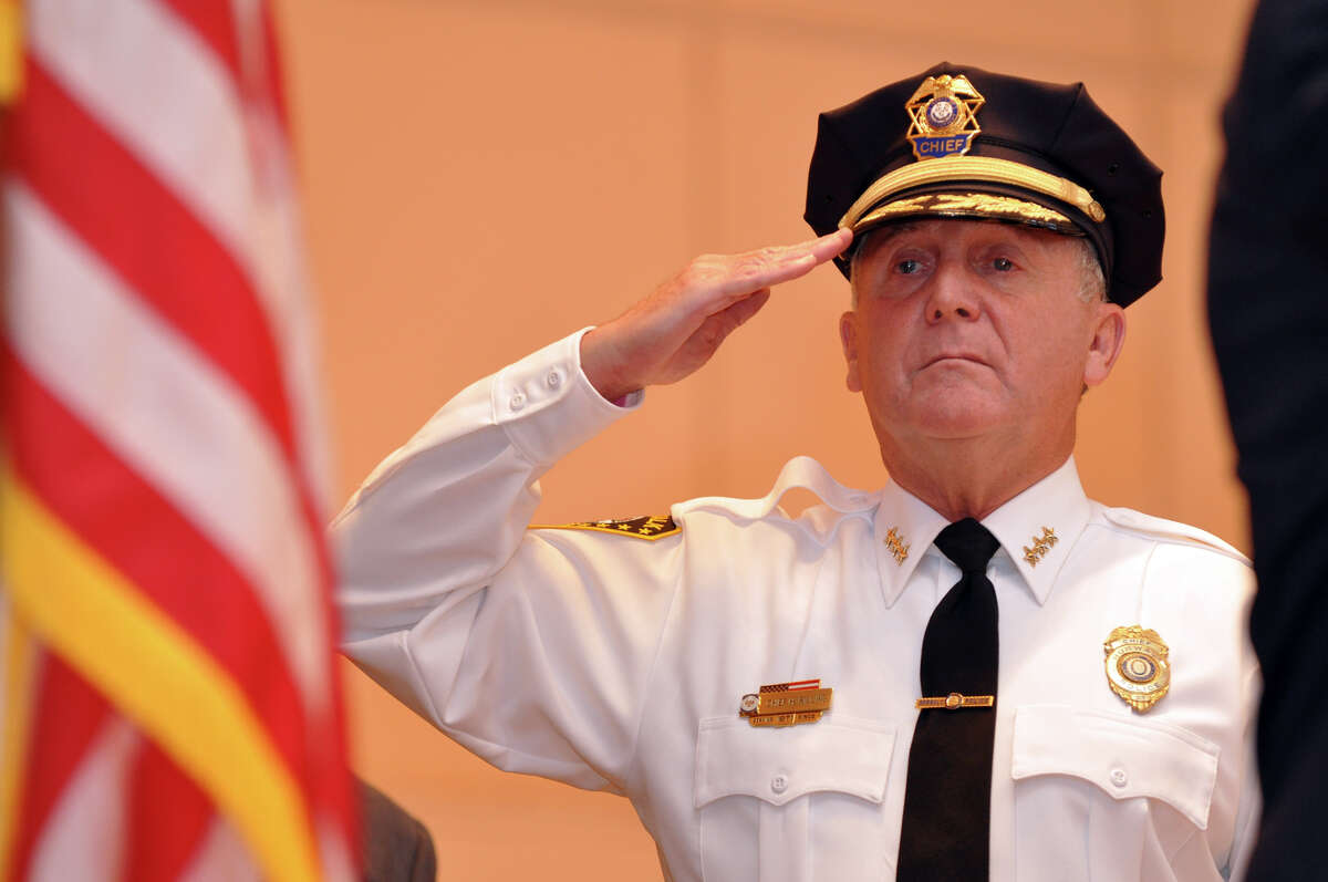 Norwalk Police Chief Harry Rilling salutes the flag during the Veterans Day ceremony at Norwalk City Hall on Thursday, Nov. 11, 2010.
