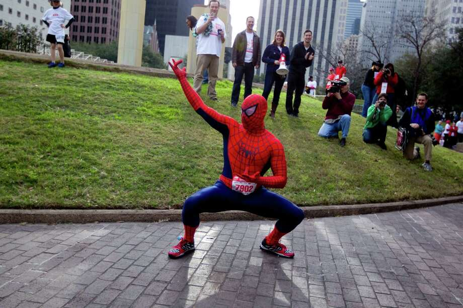 Michael Thelen of Houston dressed as Spiderman as he participated in the costume contest before the 26th annual ConocoPhillips Rodeo Run 5k and 10k that started on Walker Street downtown as part of the Houston Livestock Show and Rodeo festivities Friday, Feb. 22, 2013, in Houston. 
