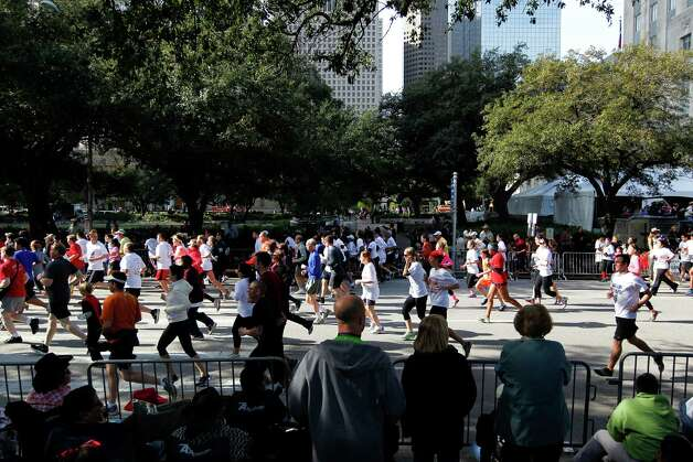 Thousands of runners flood the street during the 26th annual ConocoPhillips Rodeo Run 5k and 10k that started on Walker Street downtown as part of the Houston Livestock Show and Rodeo festivities Friday, Feb. 22, 2013, in Houston. 