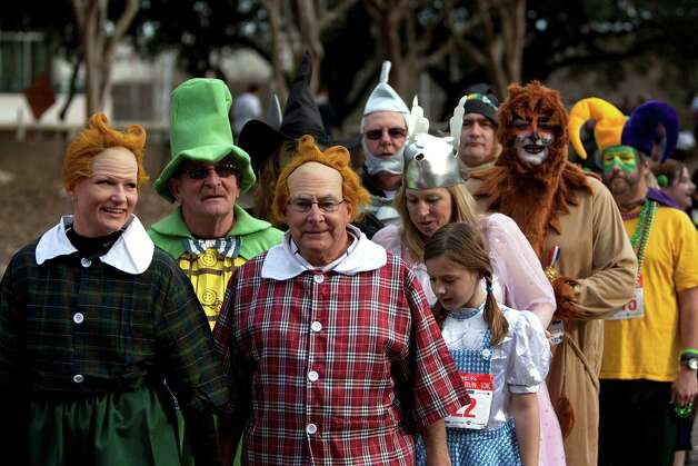 A group dressed as characters from the Wizard of Oz participated in the costume contest before the 26th annual ConocoPhillips Rodeo Run 5k and 10k that started on Walker Street downtown as part of the Houston Livestock Show and Rodeo festivities Friday, Feb. 22, 2013, in Houston. 