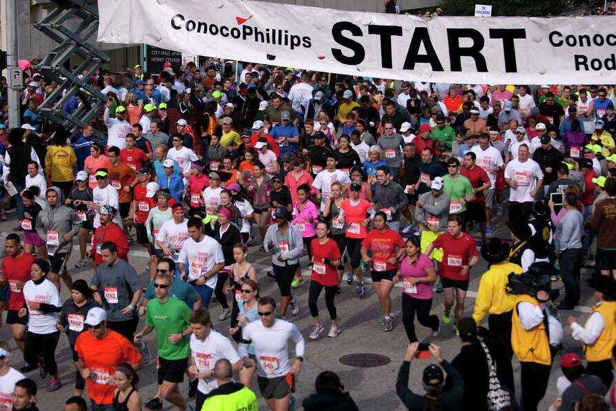 Thousands of runners flood the street during the 26th annual ConocoPhillips Rodeo Run 5k and 10k tha