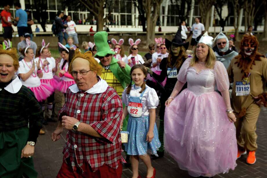 A group dressed as characters from the Wizard of Oz participated in the costume contest before the 26th annual ConocoPhillips Rodeo Run 5k and 10k that started on Walker Street downtown as part of the Houston Livestock Show and Rodeo festivities Friday, Feb. 22, 2013, in Houston.  The Rodeo Run raises scholarship funds for Texas youth. Since 1988, ConocoPhillips has donated all Rodeo Run entry fees to the HLSR Educational Fund, totaling $3.3 million to date.   Last year, a record 15,000 participants took part in the Rodeo Run, generating a record $400,000 for college scholarships. Photo: Johnny Hanson, Houston Chronicle / © 2013  Houston Chronicle