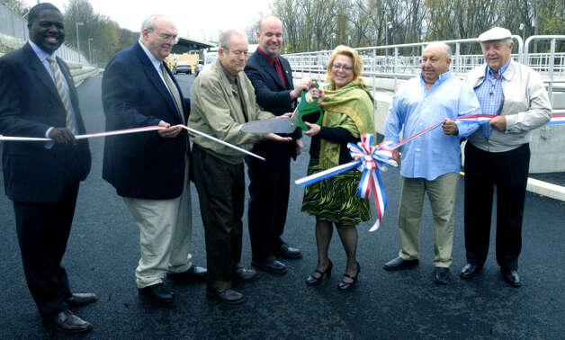 An April 11 2012 ribbon-cutting to celebrate the completion of the New Milford sewer plant renovation and expansion featured a VIP cast including, from left to right, Chris Blocker, the town's economic development supervisor, plant supervisor Ken Bailey, former Sewer Commission chairman Bill Johnson, current commission chairman Frank Bidetti, Mayor Pat Murphy, and former commission chairmen Tom Pilla and John Heaton. Photo: Norm Cummings
