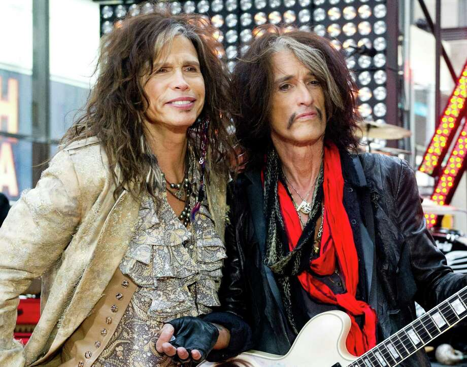 """FILE - This Nov. 2, 2012 file photo shows Steven Tyler, left, and Joe Perry of Aerosmith on NBC's """"Today"""" show in New York. Perry and Tyler of Aerosmith and Mick Jones and Lou Gramm of Foreigner will join the Songwriters Hall of Fame  this year along with the writers of iconic rock hits """"Love Is a Battlefield"""" and """"Heartache Tonight"""" during a June 13 ceremony in New York.(Photo by Charles Sykes/Invision/AP, file) Photo: Charles Sykes"""