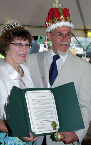 Mary and Chris Prause show off the proclamation designating them as king and queen of the Greater New Milford Chamber of Commerce's 45th annual Village Fair Days. July 27, 2012 Photo: Trish Haldin