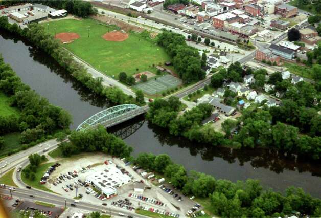 An aerial shot of Veterans Memorial Bridge, Route 7, the Housatonic River and downtown New Milford on July 9, 2003, thanks to Preston Aviation of Sherman. Photo: Norm Cummings, Norm Cummings/Spectrum / The News-Times