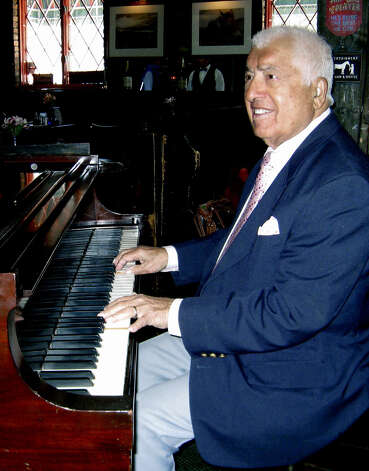 Dolph Traymon, owner and almost 90-year-old pianist at the Fife'n Drum Restaurant in Kent, performs on the piano on Feb. 4, 2009 Photo: Norm Cummings