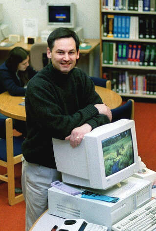 Carl DiMilia, acting director of tne New Milford Public Library on Jan 9, 2001 soon begins a long tenure as the fulltime director.  Spectrum file photo Photo: Contributed Photo / The News-Times Contributed