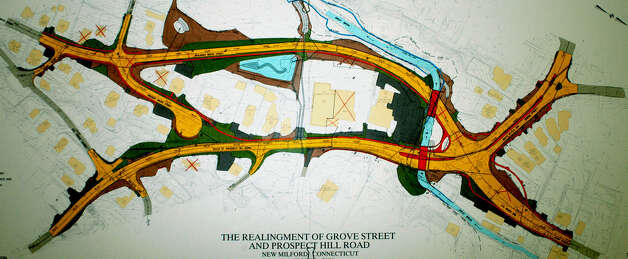 "The state DOT design of the proposed ""realignment"" of the Grove Street/Route 67 intersection in New Milford, dated October 2006, displayed at April 3, 2007 meeting at town hall .                                Spectrum/After Cathy Setterlin of New Milford gets assistance with a spinning demonstration from Isabella Gimenez, Ms. Setterlin ties a woven bracelet onto the seven-year-old's wrist at Sunny Valley Preserve's Open Farm Day held Sept. 17, 2011 in New Milford. Photo: Deborah Rose"