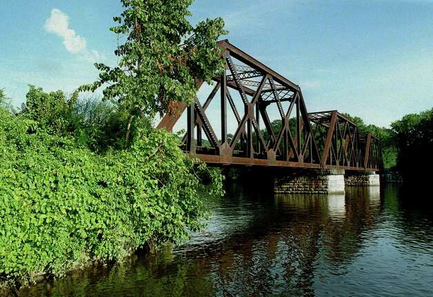 The venerable railroad bridge spanning the Housatonic River, just south of the vilage center, would get plenty more traffic if passenger service were to be returned to New Milford and points north, circa 2000 Photo: Norm Cummings, Norm Cummings/Spectrum / The News-Times