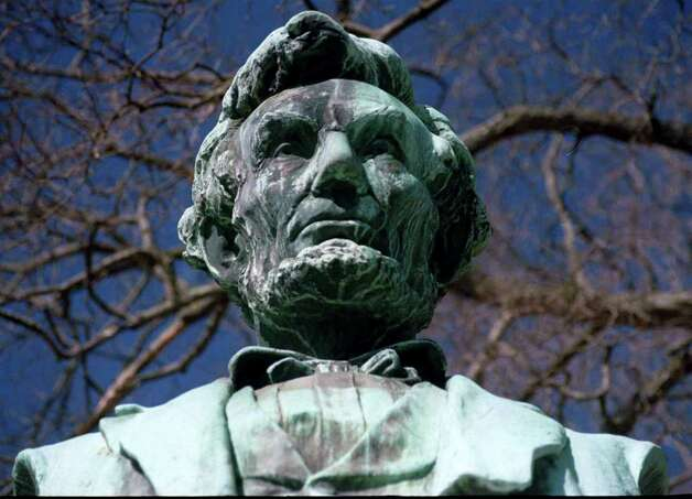 The statue of Abraham Lincoln stands watch at the north end of the Village Green in New Milford.. Photo: Norm Cummings / The News-Times