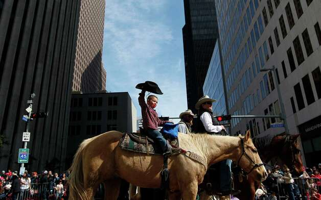 Trail riders ride down Walker Street during the 2013 Downtown Rodeo Parade Saturday, Feb. 23, 2013, in Houston. Photo: Johnny Hanson, Houston Chronicle / © 2013  Houston Chronicle