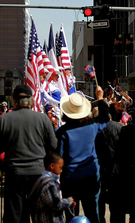Thousands gathered to watch the 2013 Downtown Rodeo Parade along Walker Street Saturday, Feb. 23, 2013, in Houston. Photo: Johnny Hanson, Houston Chronicle / © 2013  Houston Chronicle