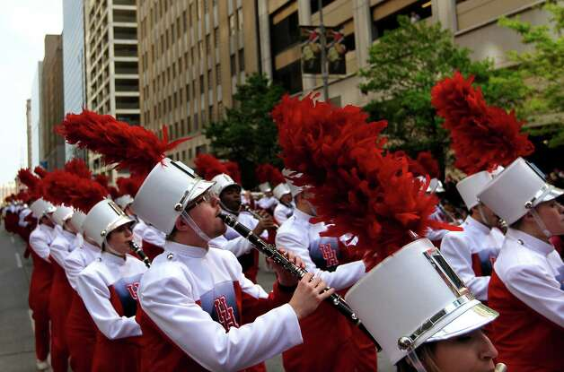 The University of Houston Cougar Marching Band performed during the 2013 Downtown Rodeo Parade Saturday, Feb. 23, 2013, in Houston. Photo: Johnny Hanson, Houston Chronicle / © 2013  Houston Chronicle