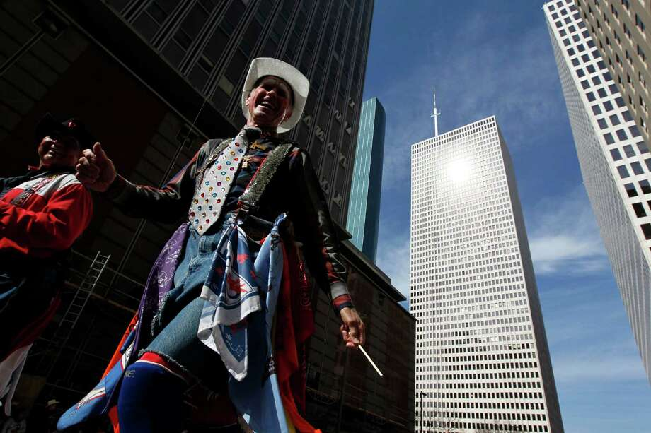 A rodeo clown walks down Walker Street during the 2013 Downtown Rodeo Parade Saturday, Feb. 23, 2013, in Houston. Photo: Johnny Hanson, Houston Chronicle / © 2013  Houston Chronicle