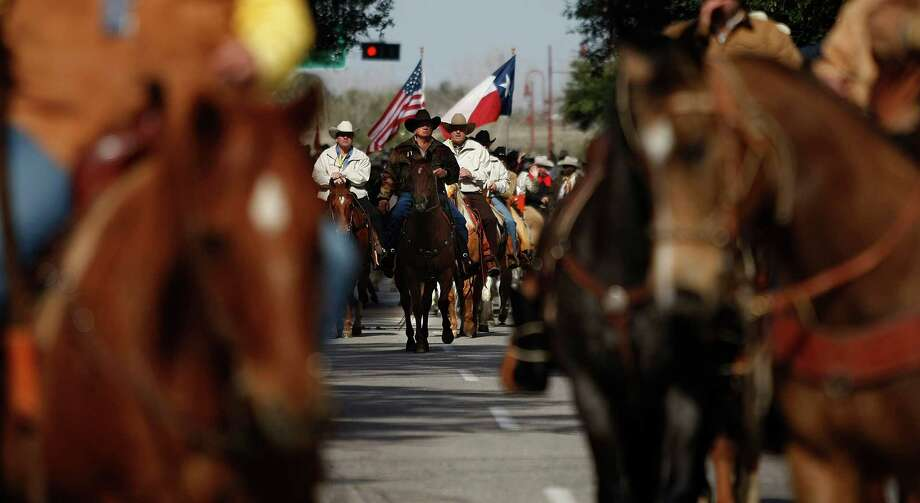 Houston Livestock Show and Rodeo committee members ride down Walker Street during the 2013 Downtown Rodeo Parade Saturday, Feb. 23, 2013, in Houston. Photo: Johnny Hanson, Houston Chronicle / © 2013  Houston Chronicle