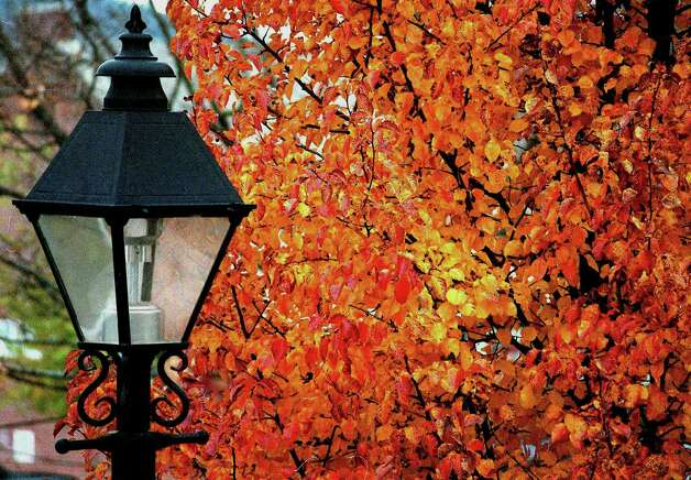 A lamppost and foliage along the Village Green in New Milford, November, 2002 Photo: Deborah Rose, Deborah Rose/Spectrum / The News-Times