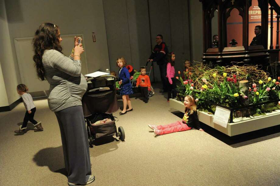 Heather Hansen, left, of Bethlehem photographs her 3-year-old daughter Abigail in front of a floral design by Evan Euripidou during the 22nd Annual New York in Bloom at the New York State Museum on Saturday Feb. 23, 2013 in Albany, N.Y. (Michael P. Farrell/Times Union) Photo: Michael P. Farrell