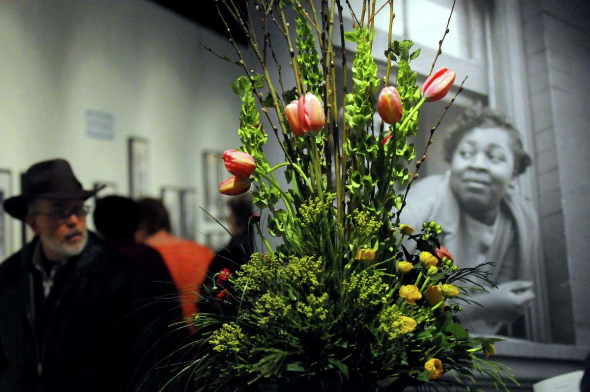A floral design by Mark Felthousen of Felthousen's Florist graces the Gordon Parks 100 Moments exhibit during the 22nd Annual New York in Bloom at the New York State Museum on Saturday Feb. 23, 2013 in Albany, N.Y. (Michael P. Farrell/Times Union)