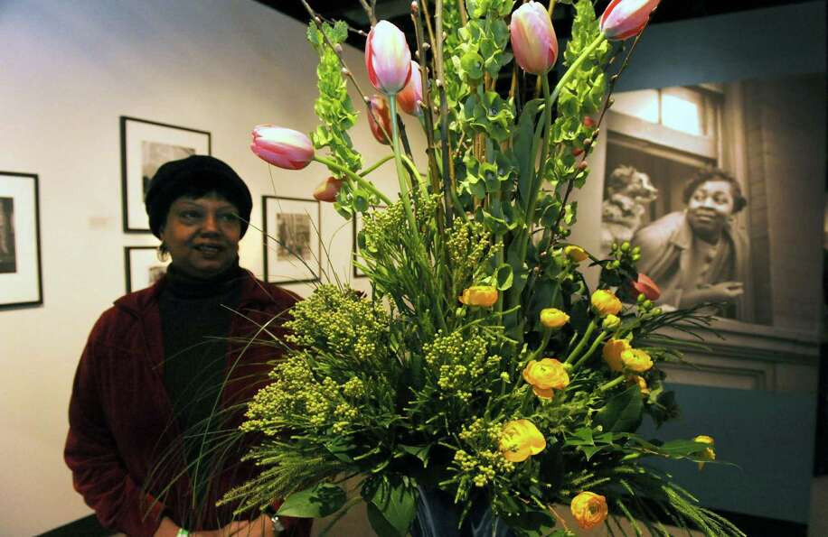 Cheryl Cannon of East Schodack looks over a floral design by Mark Felthousen of Felthousen's Florist