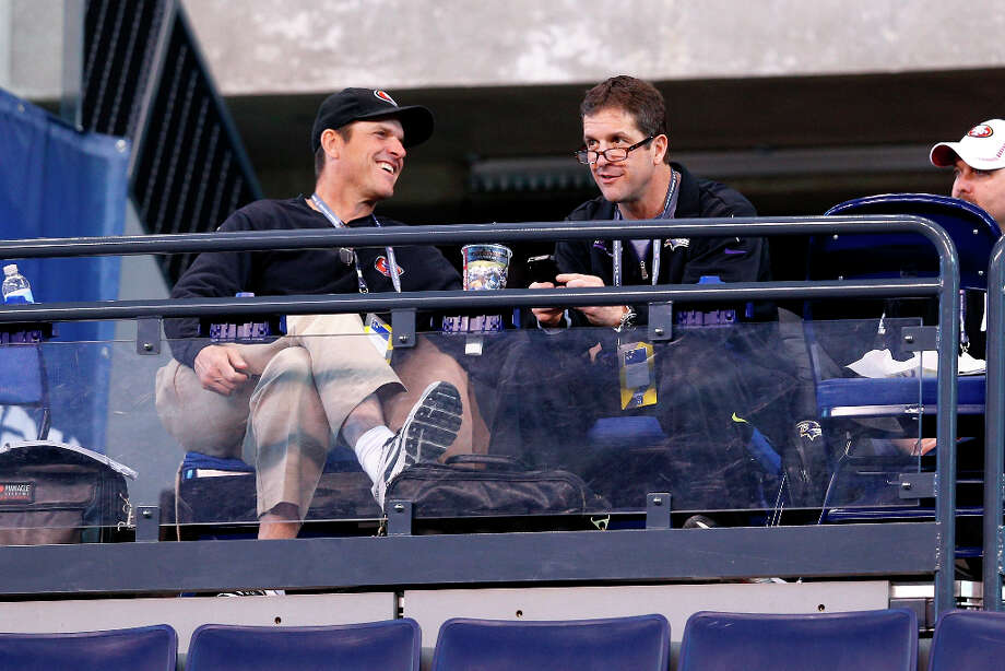 49ers coach Jim Harbaugh and Ravens coach John Harbaugh look on during the scouting combine. Photo: Joe Robbins / 2013 Getty Images