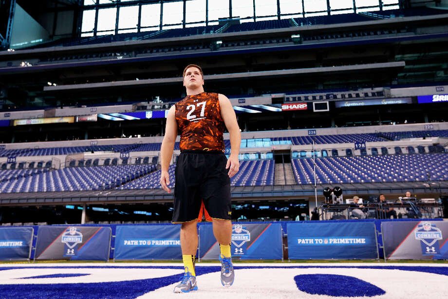 Luke Joeckel of Texas A&M looks on during the combine. Photo: Joe Robbins / 2013 Getty Images