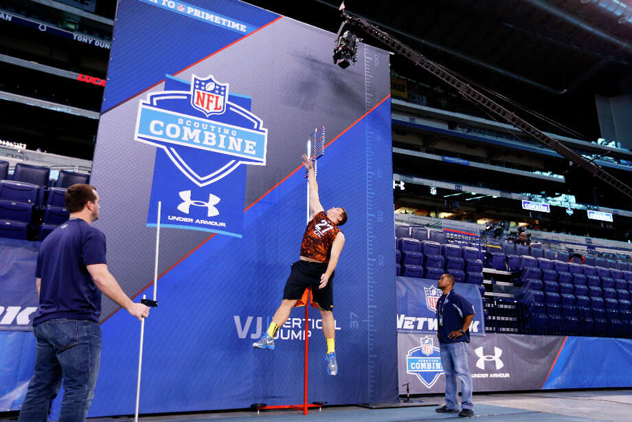 Luke Joeckel of Texas A&M gets his vertical leap measured. Photo: Joe Robbins / 2013 Getty Images