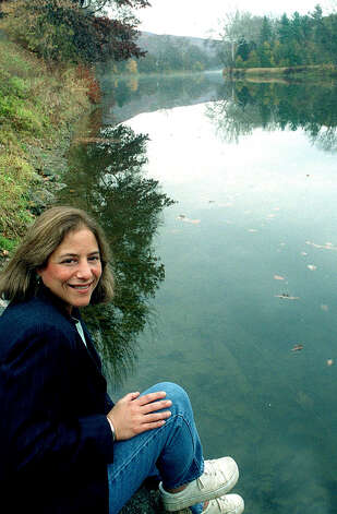 Lynn Werner, longtime director of the Housatonic Valley Association, poses along the riverbank in Kent. Photo: Norm Cummings, Norm Cummings/Spectrum / The News-Times