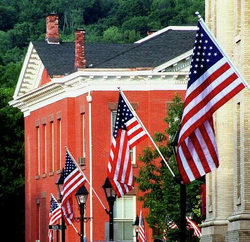 American flags fly along Bank Street and the Village Green plaza to the backdrop of Town Hall in New Milford, July 2003 Photo: Norm Cummings, Norm Cummings/Spectrum / The News-Times