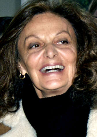 Fashion designer and longtime HVA stalwart Diane Von Furstenburg enjoys enjoys a well-deserved spotlight at Dec. 6, 2009's Housatonic Valley Association auction at Bryan Memorial Town Hall in Washington.  Photo by Trish Haldin Photo: Trish Haldin