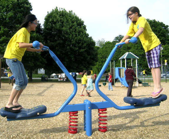 Jessica Ho, left, and Lauren Torre, both fifth-graders at Sarah Noble School, engage each other on a see saw at the new playground along Pickett District Road in New Milford, May 22, 2010. Photo: Norm Cummings