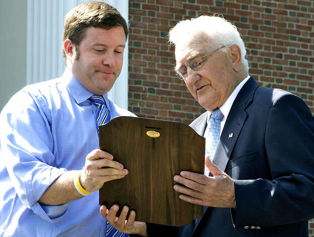 Michael Condon, left, a graduate of Shepaug Valley High School and for many years a town resident, presents the Major Stephen Reich Award for Exceptional Citizenship to Washington resident Lou Magnoli during the 2009 Memorial Day ceremony. Among his other contributions, Mr. Magnoli was honored for his 52 years' service to Rumsey Hall School as a teacher, coach and headmaster, as well as to Washington's Lions Club, the American Legion, the town's Parks & Recreation Commission and its citizenship scholarship committee. The award is given in memory of Stephen Reich, who died June 28, 2005 in Afganistan while serving with the U.S. Army Special Forces. May 25, 2009  Photo by Trish Haldin Photo: Trish Haldin