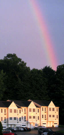 A beautiful rainbow is seen in the southeasten sky in the neighborhood of Prospect Commons in New Milford following an early-summer thunderstorm, circa 2007  Photo by Norm Cummings Photo: Norm Cummings