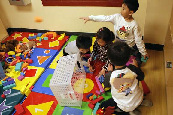 Children playing together at the YMCA in Chinatown on February 22, 2013 in San Francisco, Calif.