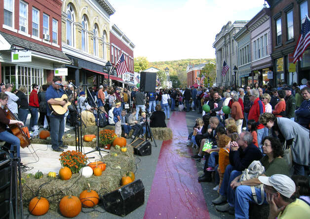 Musical entertainment is just one of the many attractions that keep Bank Street bustling with area residents nearly throughout Sunday's inaugural Bank Street Festival in the New Milford village center. Oct. 11, 2009  Photo by Norm Cummings Photo: Norm Cummings