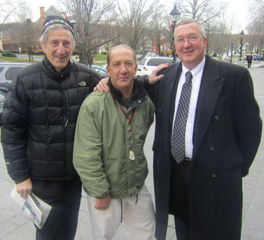 Posing for a keepskae photo outside the office of The Greater New Milford Spectrum  are, from left to right, civic patriot and bon vivant Peter Orenski, charitable cause activist Don Clady and veteran New Milford policeman Lt.  Larry Ash. Dec. 20, 2012 Photo: Norm Cummings