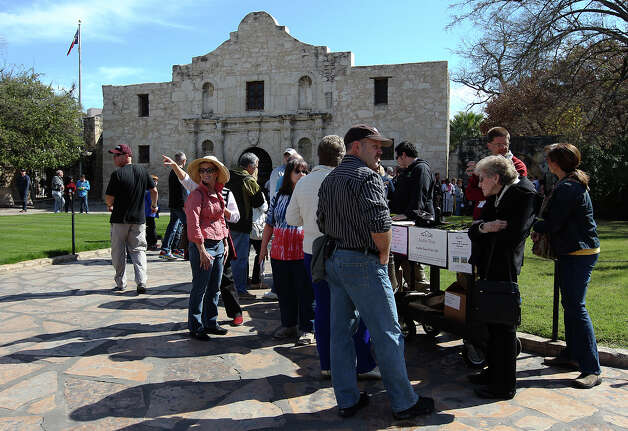 "Visitors wait in a line that wrapped around the grounds of the Alamo for an opportunity to see the historic letter written by William Barret Travis on Saturday, Feb. 23, 2012. Visitors stood in line for nearly two hours to get a glimpse of the original ""victory or death"" letter written by Travis on the first day of the exhibit. Officials are anticipating at least twice the amount of traffic than usual at the Texas Shrine. The letter will be on display at the Alamo through March 7th to commemorate the 177th anniversary of the battle at the Alamo. Photo: Kin Man Hui, San Antonio Express-News / © 2012 San Antonio Express-News"