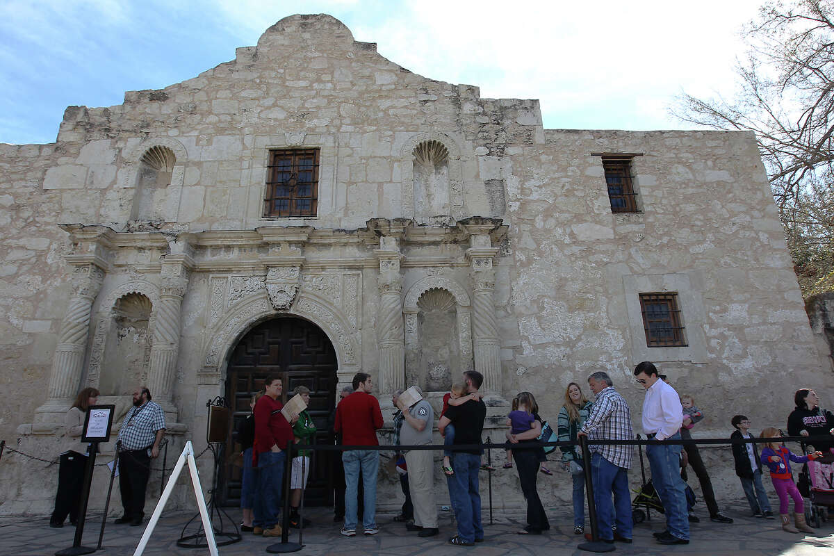 Visitors wait in a line that wrapped around the grounds of the Alamo for an opportunity to see the historic letter written by William Barret Travis on Saturday, Feb. 23, 2012. Visitors stood in line for nearly two hours to get a glimpse of the original