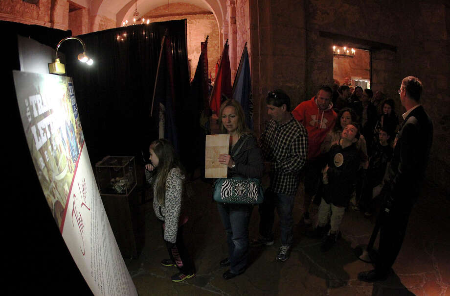 """Visitors wait in line just outside a draped area where the original historic letter written by William Barret Travis is on display in the Alamo on Saturday, Feb. 23, 2012. Visitors stood in line for nearly two hours to see the """"victory or death"""" letter written by Travis on the first day of the exhibit. Officials are anticipating at least twice the amount of traffic than usual at the Texas Shrine. The letter will be on display at the Alamo through March 7th to commemorate the 177th anniversary of the battle at the Alamo. Photo: Kin Man Hui, San Antonio Express-News / © 2012 San Antonio Express-News"""