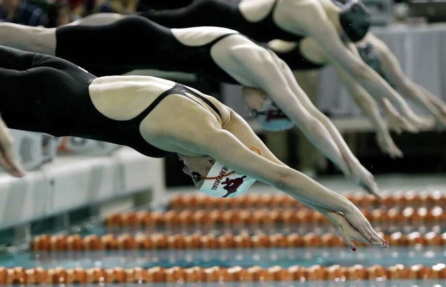 Alexandra Buscher of Memorial wins the 200-yard freestyle. Photo: Erich Schlegel, Houston Chronicle / ©2013 Erich Schlegel