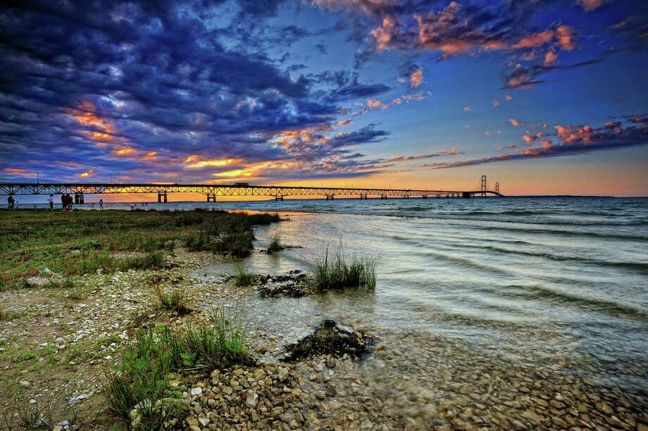 "The Headlands, Michigan  The Headlands is a vast stretch of undeveloped public land along Lake Michigan, just west of the city of Mackinaw and the Mackinac bridge (pictured). It earned its ""dark sky"" designation in 2011.  Photo: John McCormick, Getty Images/Flickr RF / Flickr RF"