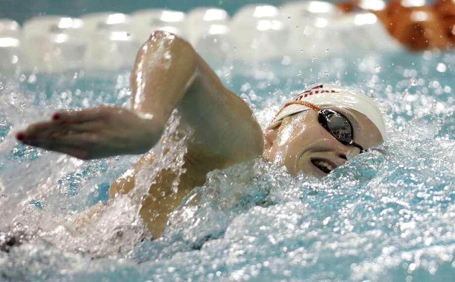Alexandra Buscher of Houston Memorial wins the 200-yard freestyle. Photo: Erich Schlegel, Houston Chronicle / ©2013 Erich Schlegel