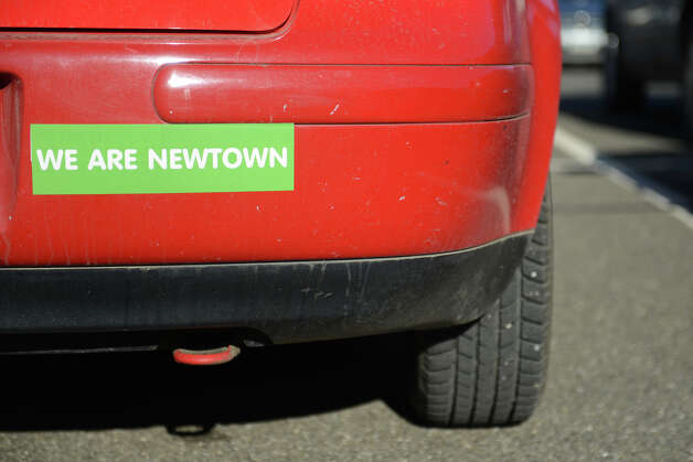 "A ""We Are Newtown"" bumper sticker on a car in Newtown, Conn. on Thursday, Feb. 21, 2013. It has been more than two months since 20 students and six staff members were killed at Sandy Hook Elementary School and the community is still recovering. Photo: Tyler Sizemore / The News-Times"