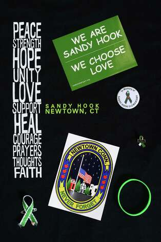 Sandy Hook T-shirts, ribbons, stickers and magnets are still for sale in some Newtown, Conn. stores on Thursday, Feb. 21, 2013. It has been more than two months since 20 students and six staff members were killed at Sandy Hook Elementary School and the community is still recovering. Photo: Tyler Sizemore / The News-Times
