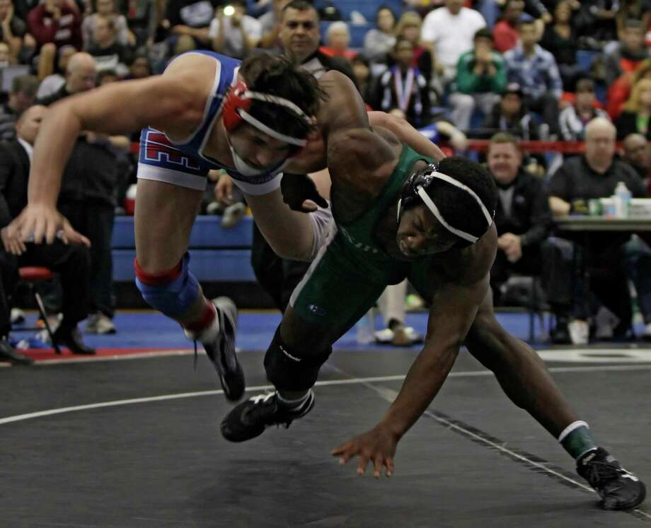 Jonathan Lowery of League City Clear Falls, right, competes against Jacob Andrews of Grapevine in the 170 lb. class. Photo: Erich Schlegel, Houston Chronicle / ©2013 Erich Schlegel