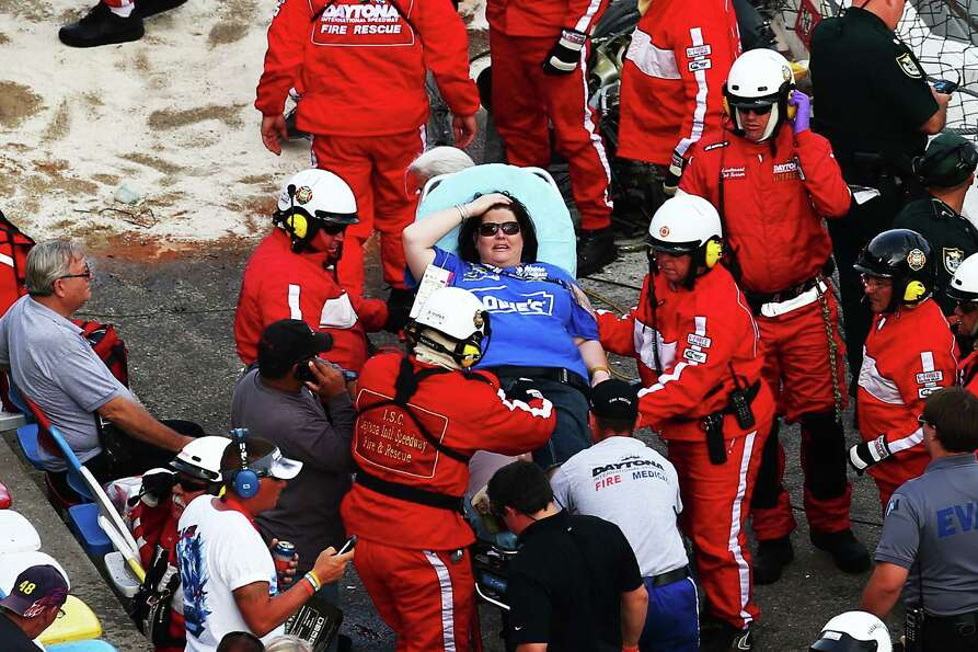Medical personnel remove an injured fan from the stands following an incident at the finish of  the