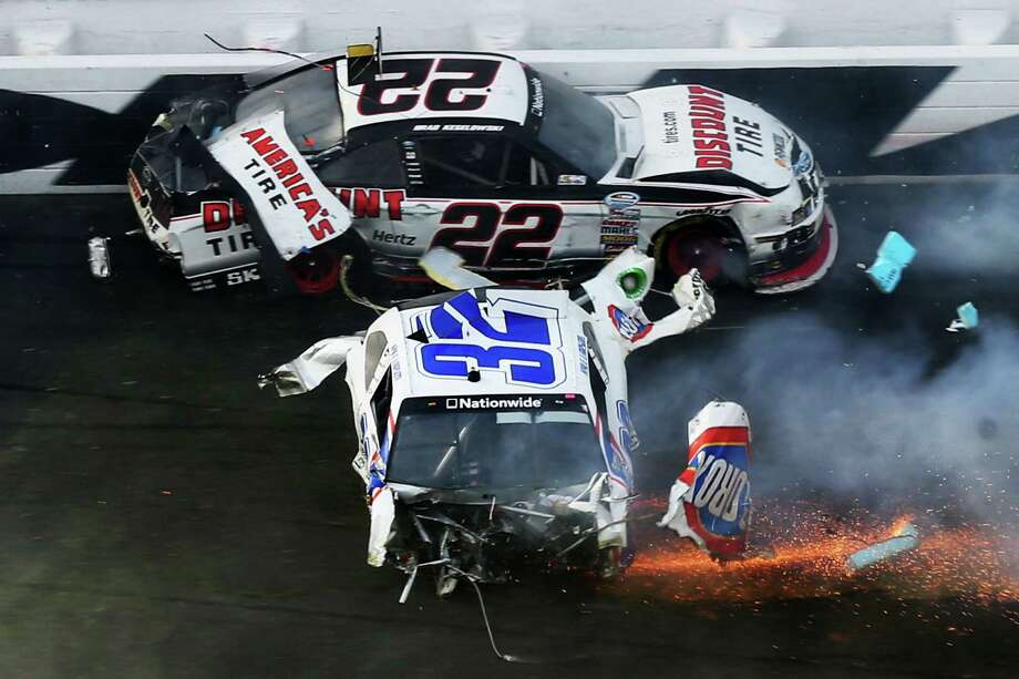 Brad Keselowski, driver of the #22 Discount Tire Dodge, and Kyle Larson, driver of the #32 Clorox Chevrolet, are involved in an incident at the finish of the NASCAR Nationwide Series DRIVE4COPD 300 at Daytona International Speedway on February 23, 2013 in Daytona Beach, Florida. Photo: Matthew Stockman, Getty Images / 2013 Getty Images